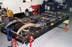 Chassis being lengthened, straightened and boxed on jig bench